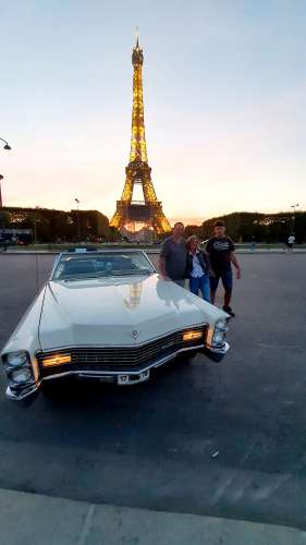 Patrick B. City Tour in Paris by Night in Cadillac